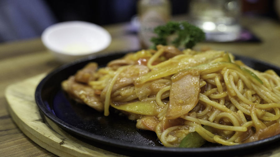 Close-Up Of Noodles In Plate On Table At Restaurant