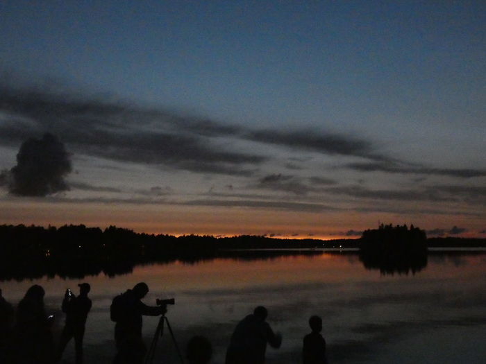 Waiting for the fireworks to begin..🎆🎆 People People Watching Photographing Beautiful Evening Nightsky Event Outdoors Sunset_collection Finland Littoinen Taking Photos Taking Pictures Littoisten Järvi Sunset Water Silhouette Tree Sky Cloud - Sky Lake Calm Camera