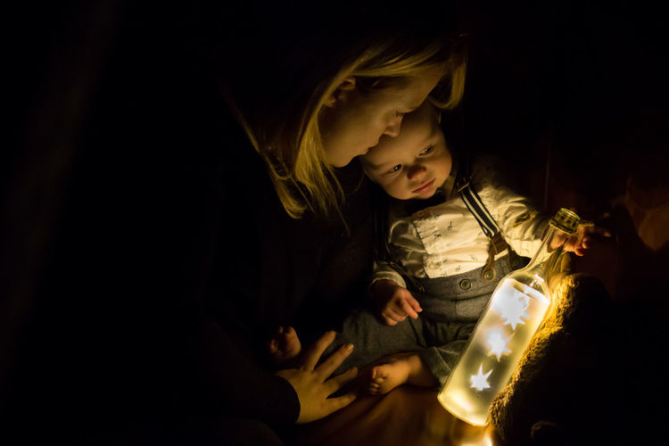 The Stars are lit Adult Baby Child Childhood Close-up Cute Baby Dim Light Happy Together   Indoors  Inquisitive Baby Learning Love Mother And Baby Night People Playing Portrait Shining Stars Stars In Bottle Streamzoofamily Togetherness Two People The Portraitist - 2017 EyeEm Awards