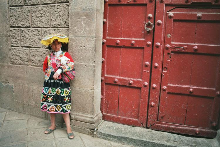 Peruvian Girl Cuzco Llama Red Door Street Photography Peru 35mm Film Traditional Dress The Street Photographer - 2016 EyeEm Awards The Portraitist - 2016 EyeEm Awards The Photojournalist - 2016 EyeEm Awards