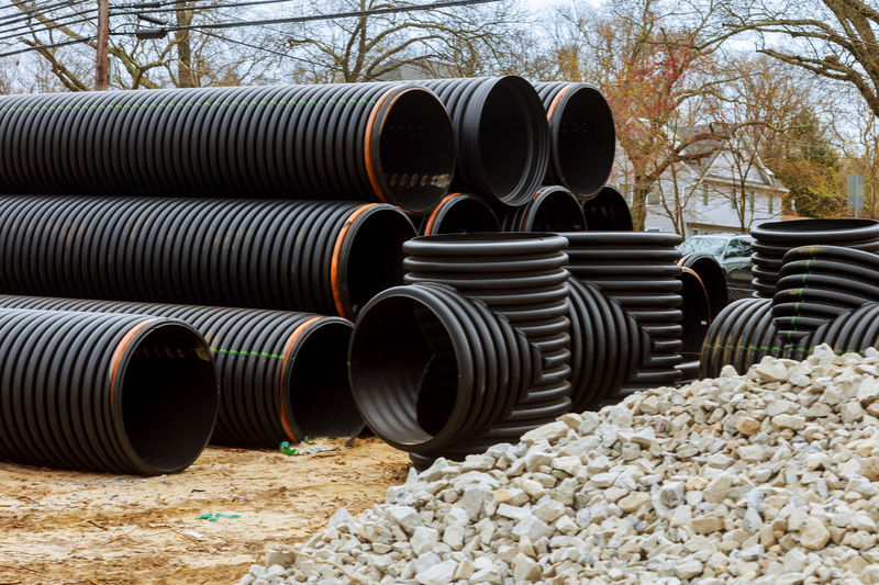 Stack of pipes on field