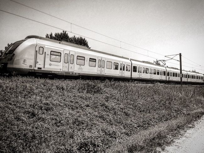 Transportation Train - Vehicle Rail Transportation Railroad Track Cable Public Transportation Travel No People Outdoors Day Sky Clear Sky Grass Nature