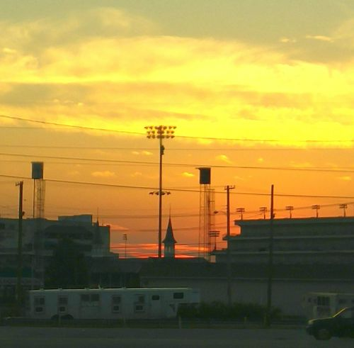 Sunset over the back side of Churchill Downs horse race track. Sunset Silhouette Architecture Cloud - Sky Dusk Orange Color City Life Louisville Kentucky Churchill Downs Spires Enjoy The New Normal The City Light Paint The Town Yellow