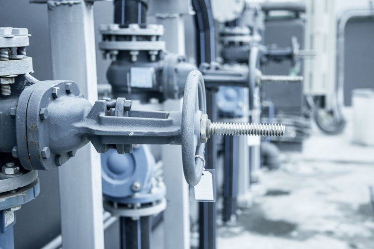 grey valve wheel handle control Alloy Business Close-up Connection Control Equipment Factory Focus On Foreground Fuel And Power Generation Industrial Equipment Industry Machine Part Machine Valve Machinery Manufacturing Equipment Metal No People Pipe - Tube Pipeline Selective Focus Steel Technology Valve
