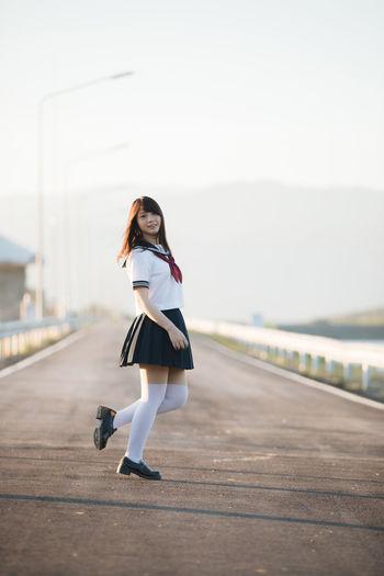 Portrait of smiling woman standing on bridge