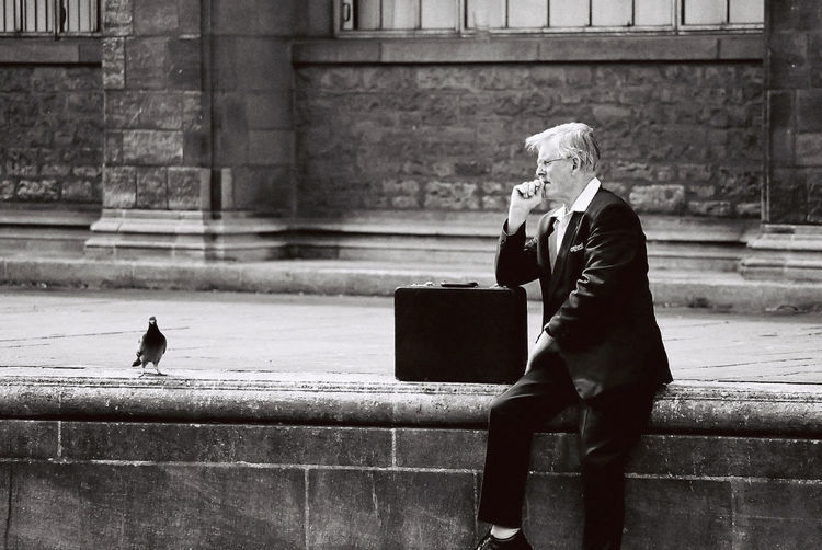 I took this photo of an academic waiting for his bus in the city of Oxford, England Academic Businessman Oxford Street Photography The Street Photographer - 2017 EyeEm Awards Well-dressed