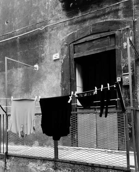 Drying Clothesline Laundry Architecture No People Hanging Built Structure Building Exterior Outdoors Day Old IItaly Sicily Day Sicily ❤️❤️❤️ Rethink Things Black And White Friday End Plastic Pollution