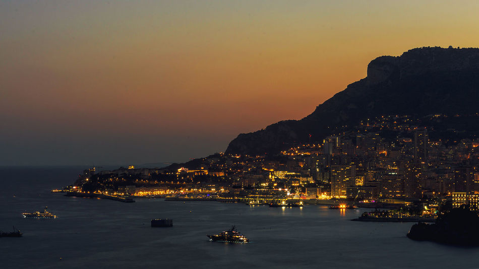Panoramic lovely view of the Principality of Monaco shortly after sunset Mediterranean Seascape Architecture Boats Building Exterior Built Structure City Cityscape French Riviera Illuminated Monaco By Night Monaco Lights Monaco Night Monaco Sunset Montecarlo Lights Montecarlo Nig Montecarlo Sunset Nature Nautical Vessel No People Outdoors Principality Of Monaco Sea Sky Water Waterfront