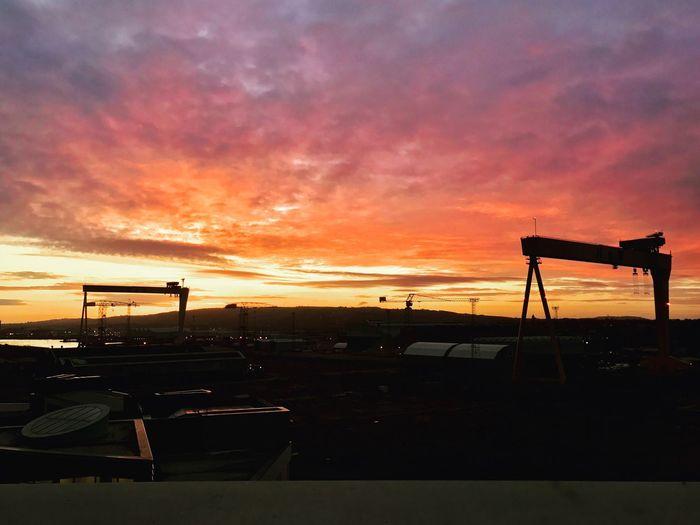 Sunrise_sunsets_aroundworld Orange Color Silhouette Sky Cloud - Sky No People Transportation Scenics Cranes Titanic