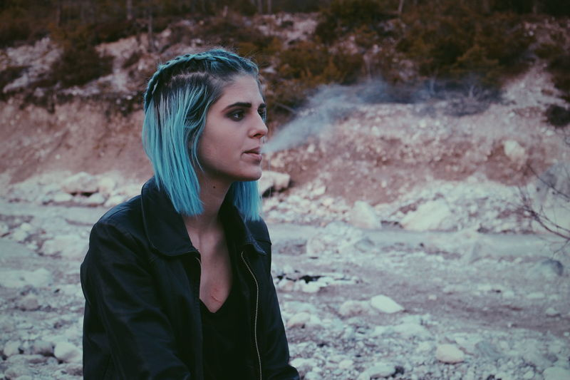 One Person Portrait Women Nature Outdoors Young Adult Day Dreaming Smoke Girl Austria BlueHair Spring Montains    Beauty In Nature