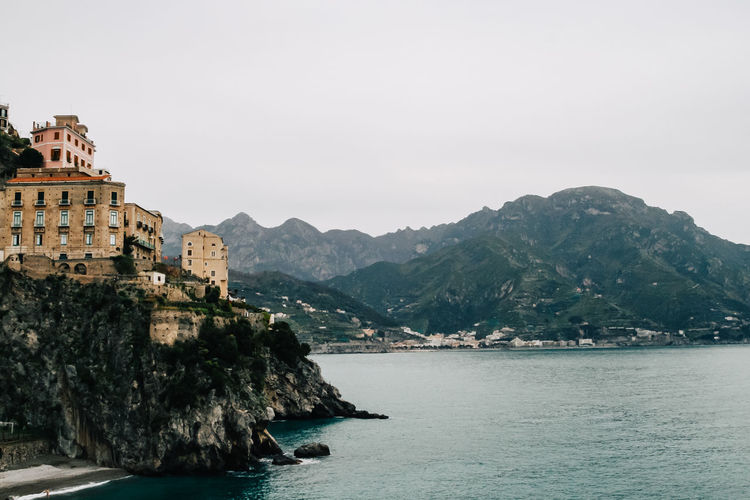 Amalfi Coast, Italy Amalfi  Amalfi Coast Architecture Beauty In Nature Building Exterior Built Structure Clear Sky Copy Space Day Italy Lake Mountain Mountain Range Nature River Scenics Sea Sky Tranquil Scene Tranquility Transportation Water Waterfront