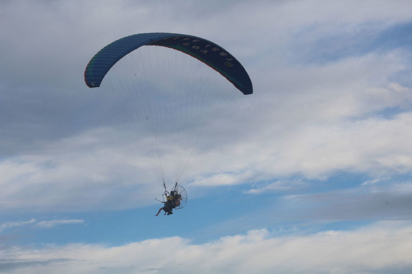 Adventure Beauty In Nature Cloud - Sky Day Extreme Sports Flying Free Flying Full Length Leisure Activity Lifestyles Low Angle View Men Mid-air Nature One Person Outdoors Parachute Paragliding People Real People Sky Sport