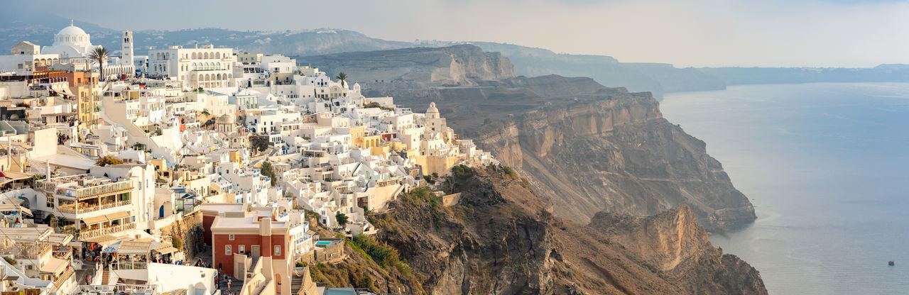 Greece Santorini Oia Thira Architecture Building Exterior City Mountain Built Structure Nature Building Day Residential District Cityscape High Angle View Travel Destinations Rock Travel Outdoors Mountain Range Crowded Sky Rock - Object Crowd TOWNSCAPE