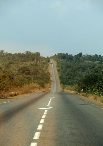 The highway to the north of Benin African Benin Road In Benin Transportation Travel Travel Photography Traveling Travelling Africa Asphalt Clear Sky Day Highway Nature No People Outdoors Road Road Marking Sky The Way Forward Transportation Travel Destinations Tree