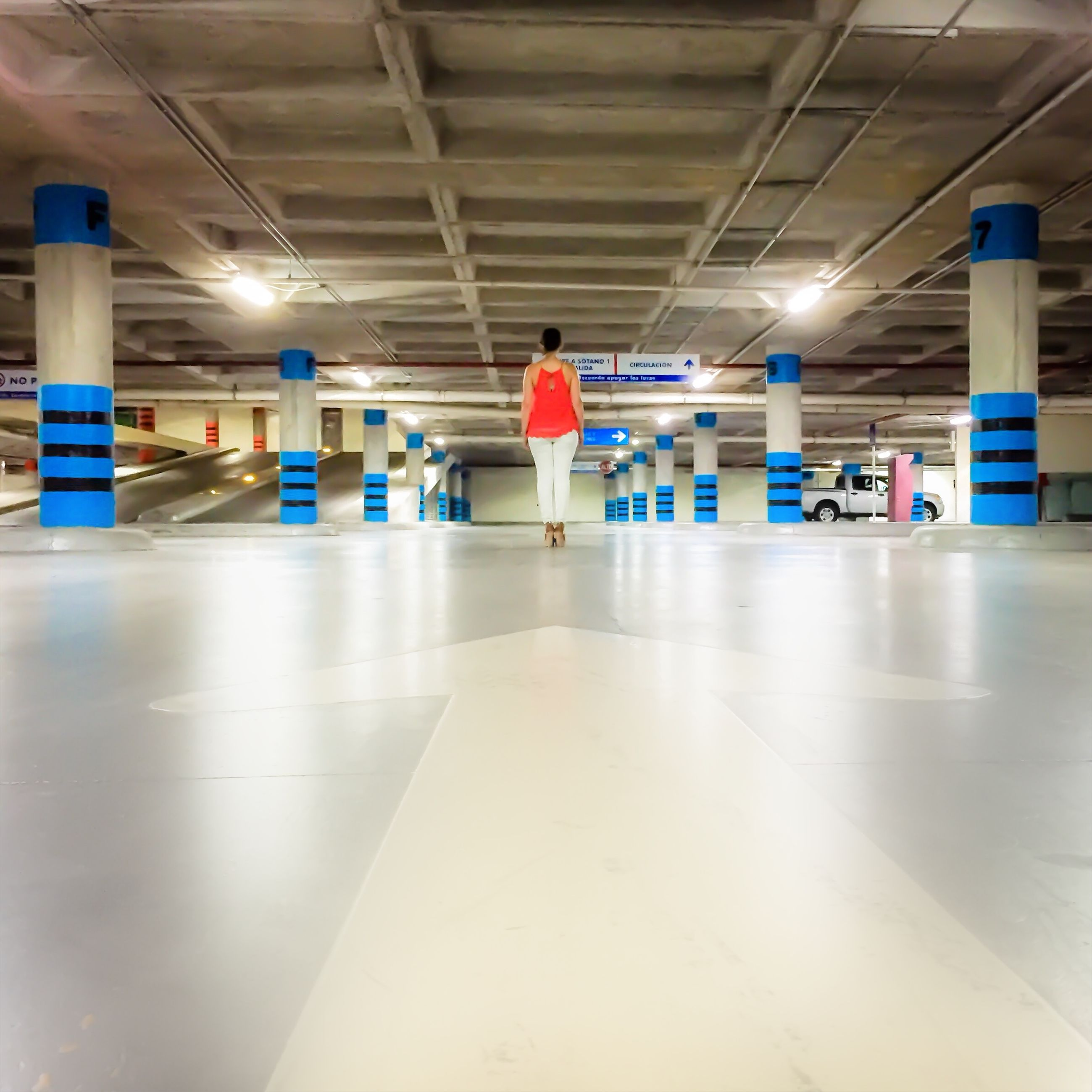 indoors, ceiling, illuminated, flooring, subway station, built structure, tiled floor, subway, empty, lighting equipment, interior, corridor, incidental people, in a row, architecture, airport, modern, blue, architectural column
