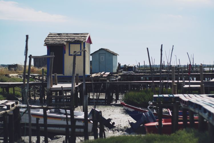 Panoramic view of buildings by river against sky