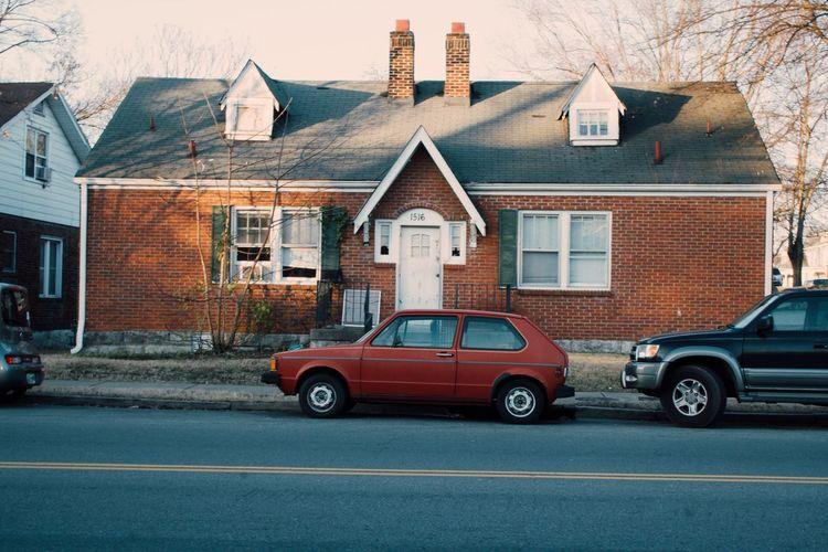 Cars on house against sky