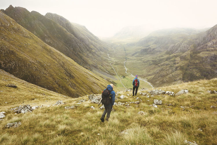 Epic Exercise Glencoe Scotland Adventure Beauty In Nature Friendship Healthy Lifestyle Hiking Landscape Lifestyles Men Mountain Mountain Range Nature Outdoors Real People Rear View Togetherness Travel Destinations Two People Vacations Walking Wild Wilderness