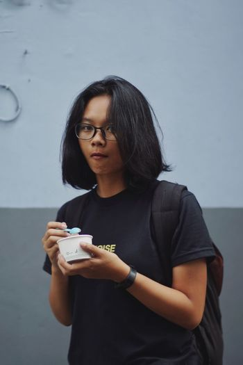 """""""Not sharing my ice cream"""" Eyeem Philippines Philippines Ice Cream Real People One Person Young Adult Black Hair Front View Young Women Leisure Activity Casual Clothing Close-up Indoors  Eyeglasses  Portrait Lifestyles EyeEmNewHere"""