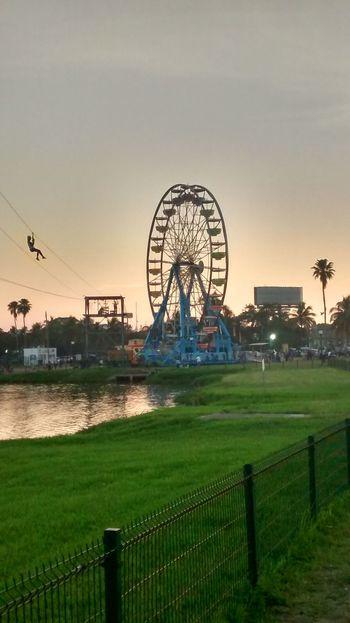 Amusement Park Ferris Wheel Rollercoaster Amusement Park Ride Sunset Sky Outdoors Grass No People Nature Day