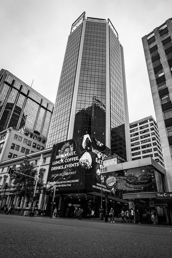 black and white of a skyscraper in auckland new zealand Architecture Auckland City Architecture Black And White Building Building Exterior Built Structure City Communication Day Low Angle View Modern Nature New Zealand No People Office Office Building Exterior Outdoors Representation Sky Skyscraper Tall - High The Architect - 2018 EyeEm Awards