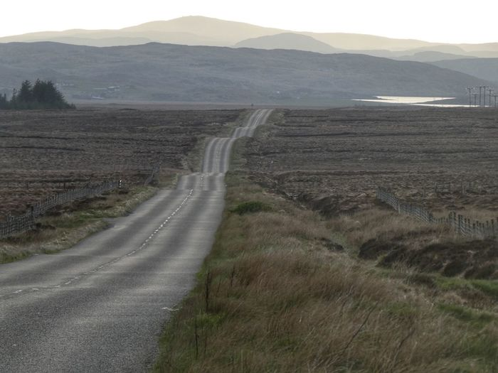 Long road in Lewis Long Road Isle Of Lewis Outer Hebrides VisitScotland Scotland Environment Mountain Landscape Road Scenics - Nature Day Beauty In Nature Tranquil Scene Nature Tranquility Non-urban Scene No People The Way Forward Transportation Land Dirt Direction Plant Sky