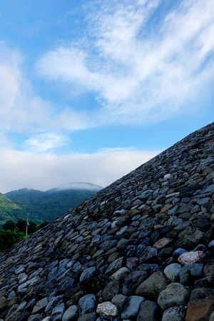 Sky Cloud - Sky Day Nature Tranquility Tranquil Scene Scenics - Nature No People Beauty In Nature Rock Plant Solid Stone Outdoors Landscape Rock - Object