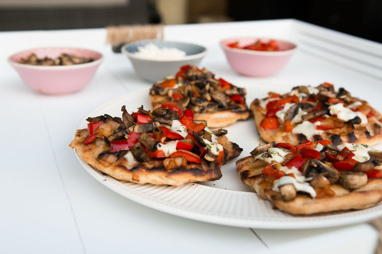 Pizzas in plate on table
