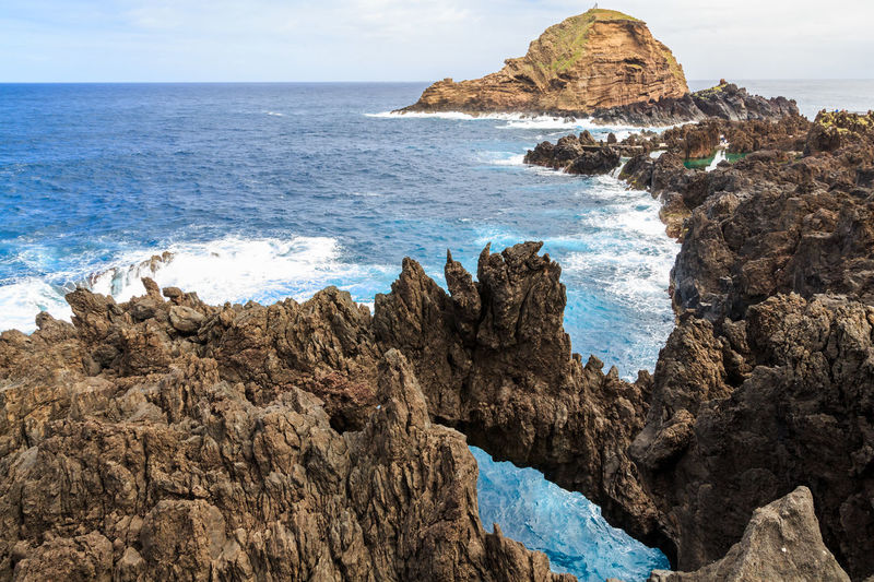 Madeira Islands, Portugal Sea Rock Water Rock - Object Beauty In Nature Sky Scenics - Nature Solid Land Beach Rock Formation Horizon Horizon Over Water Nature Tranquility Tranquil Scene No People Day Motion Eroded Rocky Coastline Stack Rock