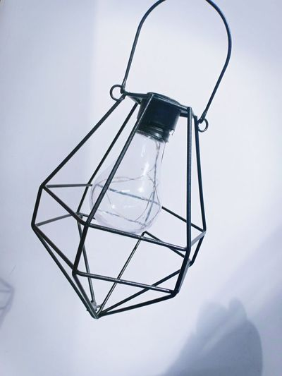 Low angle view of light bulb hanging on mountain
