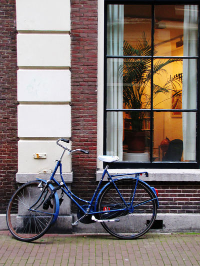 Bicycle Series Bicycle Brick Wall Building Exterior Built Structure City Day Land Vehicle Mode Of Transport No People Outdoors Reflection Stationary Transportation Window Wall - Building Feature Street Photography EyeEmBestShots Street Photography Street Life Cycling Photography Architecture_collection Cycling Motion