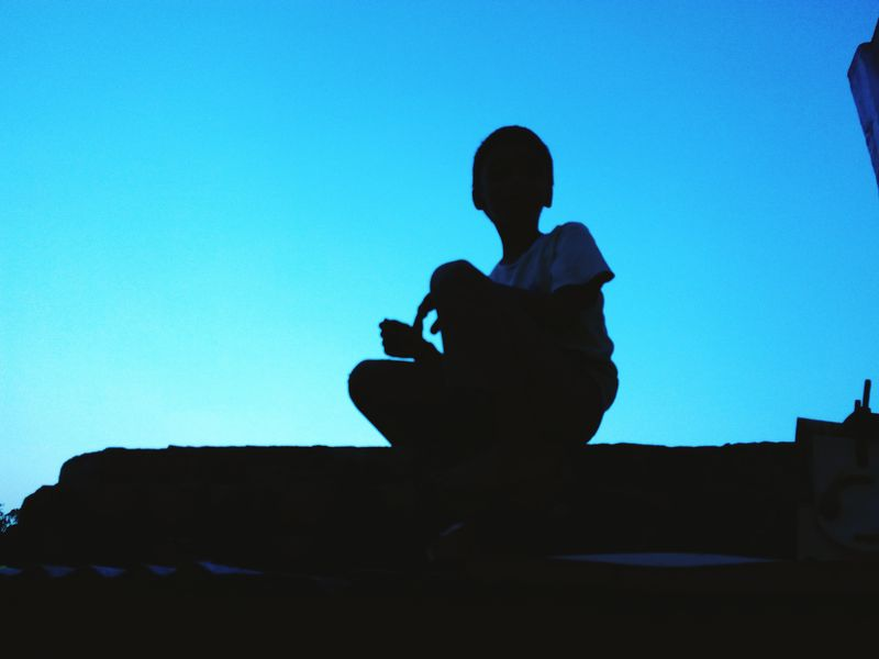 EyeEmNewHere Alone Sitting One Person Clear Sky Terrace Twilight Sky Outdoors One Man Only
