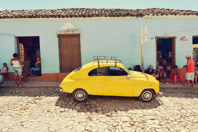 Yellow vintage car on street