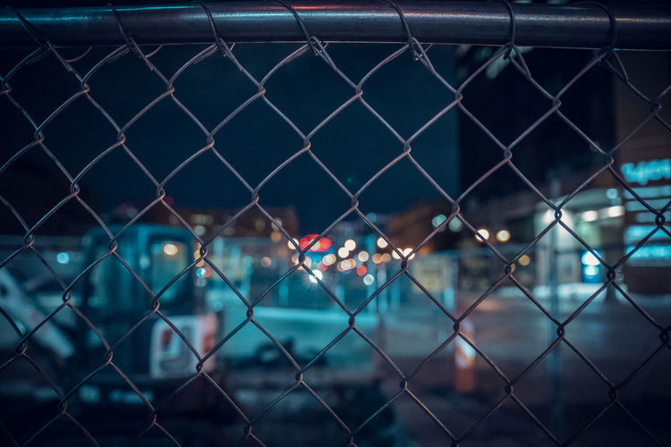 Full Frame Shot Of Chainlink Fence At Night