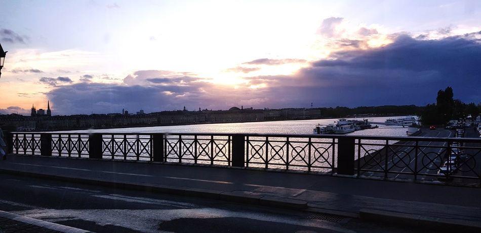 Water Sea Sunset Beach Bridge - Man Made Structure Sunlight Railing Sky Horizon Over Water Cloud - Sky