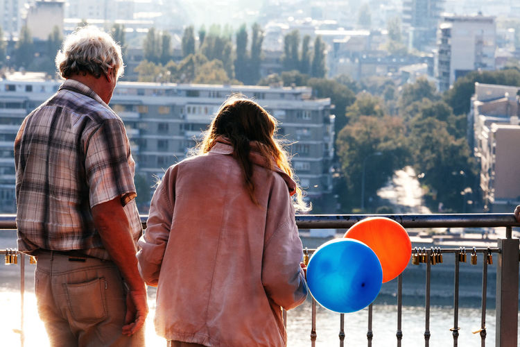 Forever. Forever Gray Hair Love Adult Balloon Bonding Casual Clothing City Cityscape Couple - Relationship Day Leisure Activity Men Outdoors People Positive Emotion Real People Rear View Sunshine Togetherness Two People Women