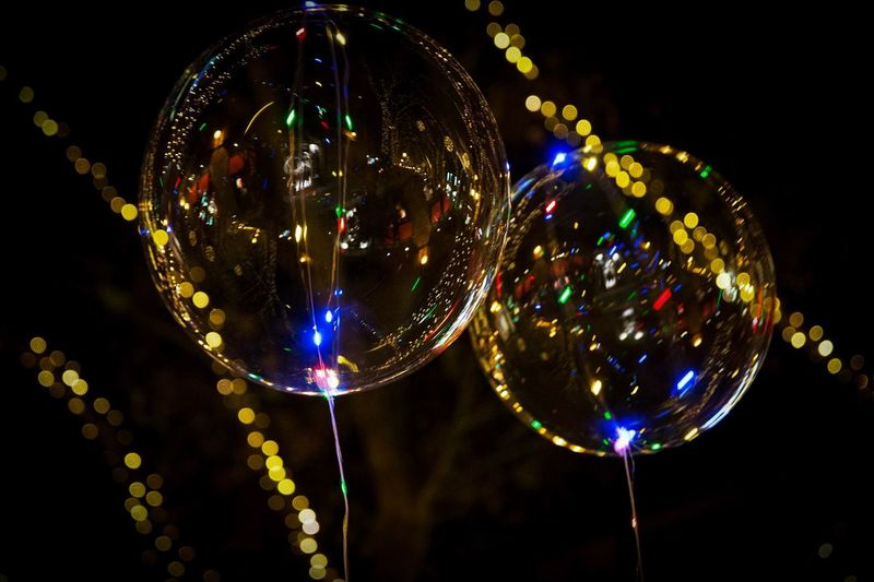 Low Angle View Of Transparent Balloons At Night