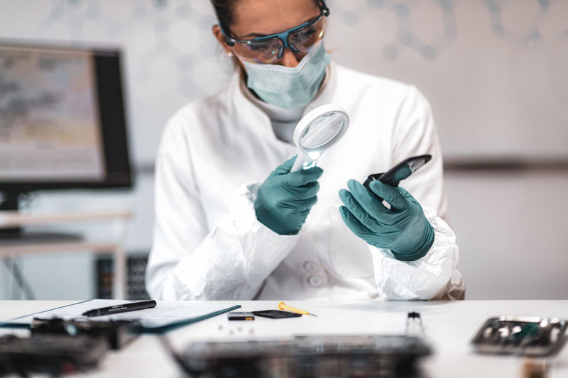 Female scientist working at crime laboratory