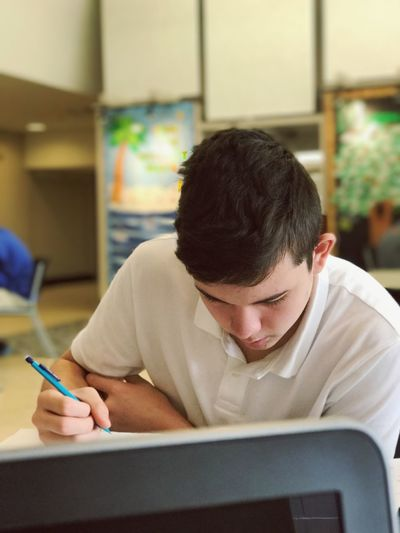 Young Man Studying In College