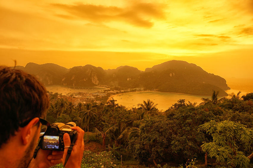 Photographing the sunset @Koh Phi Phi Don viewpoint - Krabi Province, Thailand Adventure Camera - Photographic Equipment Close-up Dawn Digital Viewfinder Human Hand Island Island Life Koh Phiphi Landscape Nature One Person Outdoors Photographing Sky Sunset Tree My Year My View Yellow Color Yellow Dawn Yellow Sky Uniqueness Miles Away Summer Exploratorium