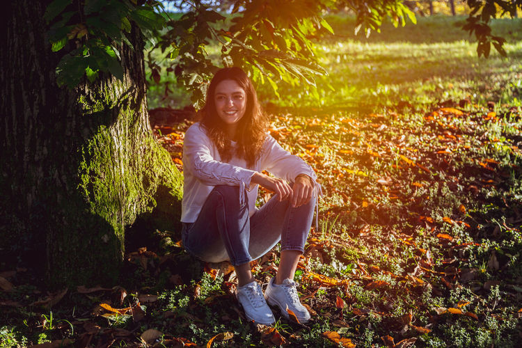 Portrait of smiling young woman during autumn