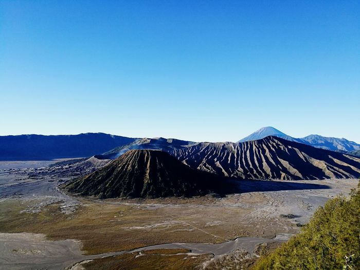 Mountain Volcano Volcanic Landscape No People Sky Outdoors Nature Landscape Clear Sky Day Beauty In Nature Power In Nature Dry Sand Rock Bed Bromo Tengger Semeru National Park Mountain Range Bromo Mountain Sun Travel Destinations Leisure Activity Beauty In Nature Scenics