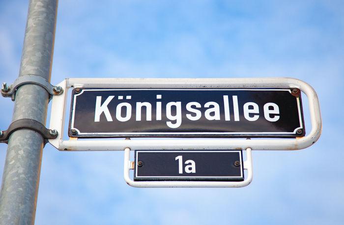 Koenigsallee road sign in Dusseldorf, Germany Düsseldorf Düsseldorf ♡ Germany Königsallee Northrhein Westfalia Road Sign Shopping Street Sign West Germany