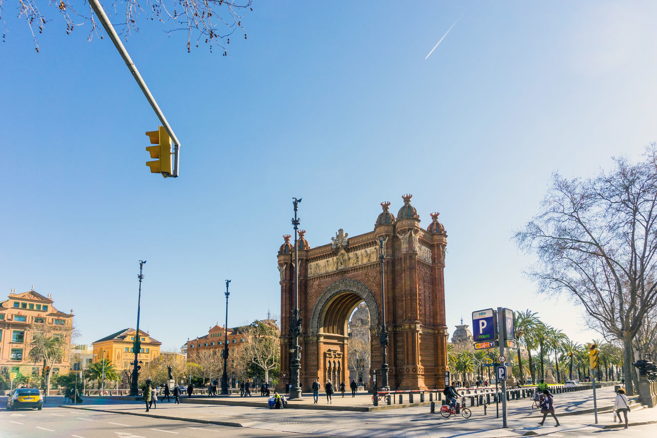 People Walking By Arc De Triomf During Sunny Day