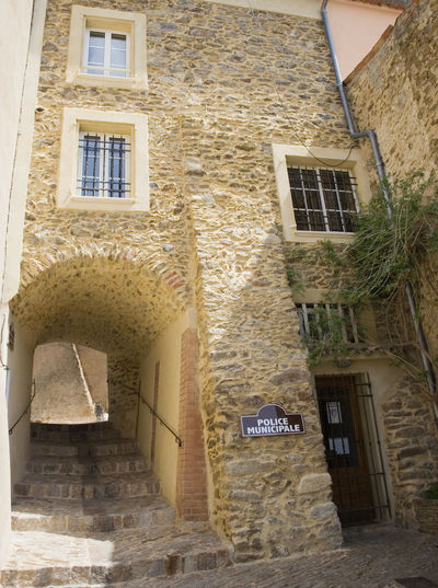 police station in france - in gassin, village on the french riviera Ancient Architecture Brick Wall Building Exterior Built Structure Côte D'Azur France French Gassin Low Angle View Mediterranean  No People Old Old Town Outdoors Police Police Municipale Police Station Politics And Government Provence Rustic Steps Steps And Staircases Stone Wall Village