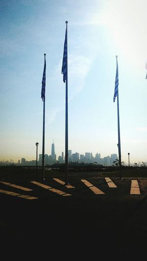 Nycskyline  NYC Photography Battle Of The Cities Statue Of Liberty Statues And Monuments Architecture Clear Sky Tranquility Tall - High Outdoors Flag Bestcityever Neverwanttoleave