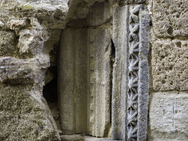 Ancient Ancient Civilization Archaeology Architectural Column Architecture Bas Relief Building Building Exterior Built Structure Carving - Craft Product Close-up Day History No People Old Old Ruin Ruined Solid Stone Material Stone Wall Storm Cloud The Past Wall Wall - Building Feature Weathered