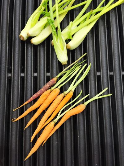 High Angle View Of Carrots And Fennels Grilling On Barbecue
