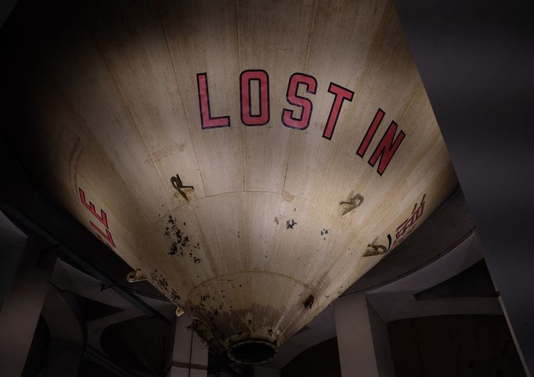 Low angle view of text on ceiling