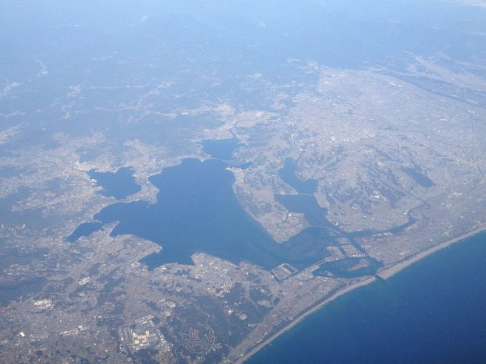 Hamanako-lake on a flight from Oita to Tokyo. Landscape Hello World From An Airplane Window On The Plane